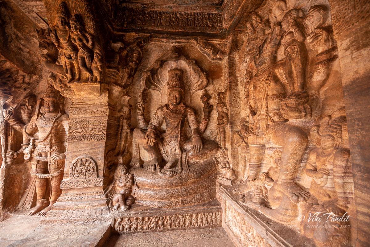 A sculpture of Vishnu sitting at Cave Temple 3