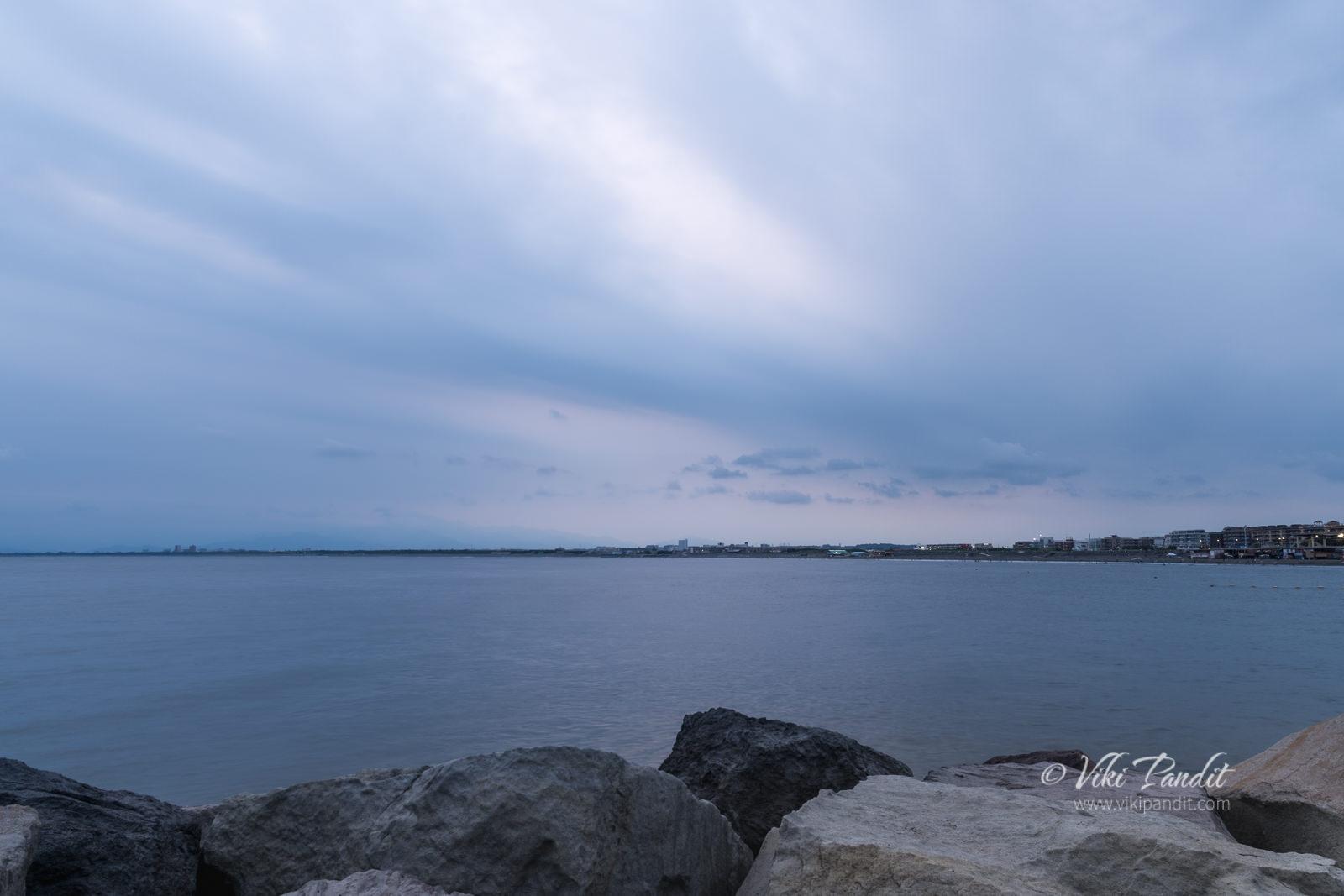 Rocks along wooden pier at Shonan