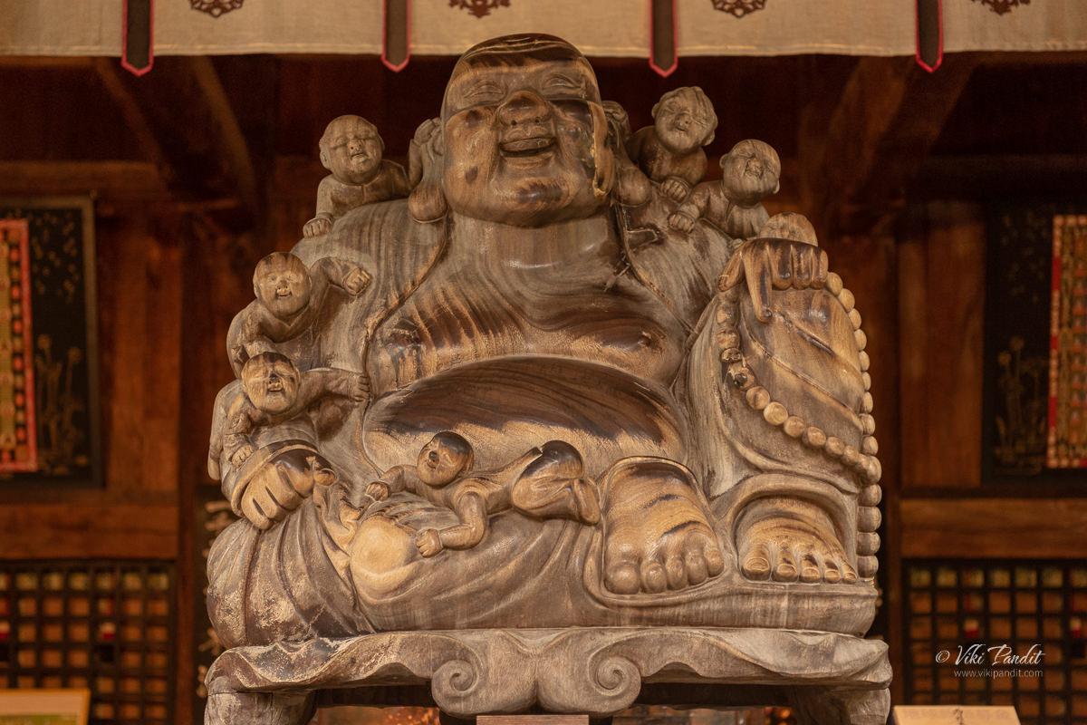 The wooden Buddha inside Konpon Chudo at Yamadera Temple Grounds