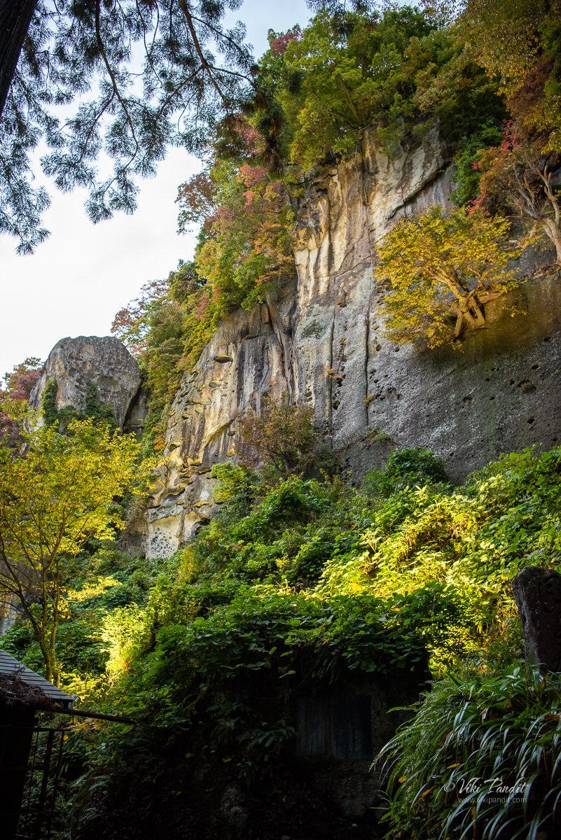 Illuminated weathered rocks on the side of Yamadera